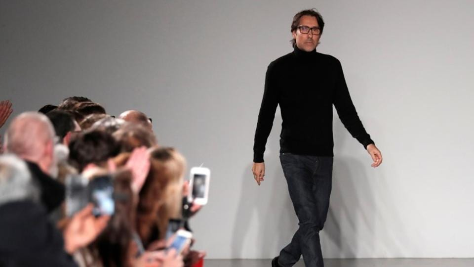 French designer Christophe Josse appears at the end of his Haute Couture Spring-Summer 2018 fashion show in Paris.