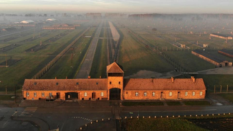 The railway entrance to former German Nazi death camp Auschwitz II - Birkenau with its SS guards tower. Commemorations have been planned in Jerusalem on January 23, with the presence of Russian President Vladimir Putin and his French counterpart Emmanuel Macron, and in Poland on January 27. (Pablo Gonzalez / AFP)