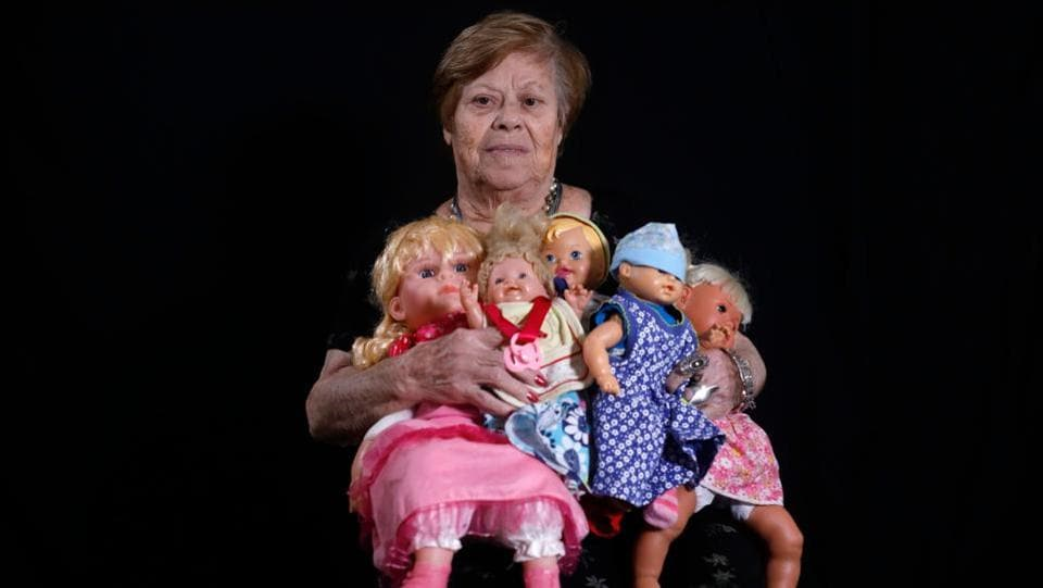 Holocaust survivor Malka Zaken, 91, poses with dolls, reminders of her childhood with her mother who was killed by the Nazis, at her home in Tel Aviv. Born in Greece in 1928, she was 12 when she was sent to the death camp, assigned to fold the clothes of Jews killed in the gas chamber, and recalls the fear at Auschwitz. When the memories become too much, she turns to her dolls. (Menahem Kahana / AFP)