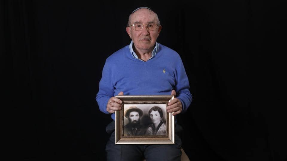 Szmul Icek shows a picture of his parents killed by the Nazis, at his home in Jerusalem. Born in Poland in 1927, he and two brothers survived while their parents and two sisters were killed in the Holocaust, and, in contrast to some survivors, he never returned to the camp after the war and avoids reading books on the subject. (Menahem Kahana / AFP)