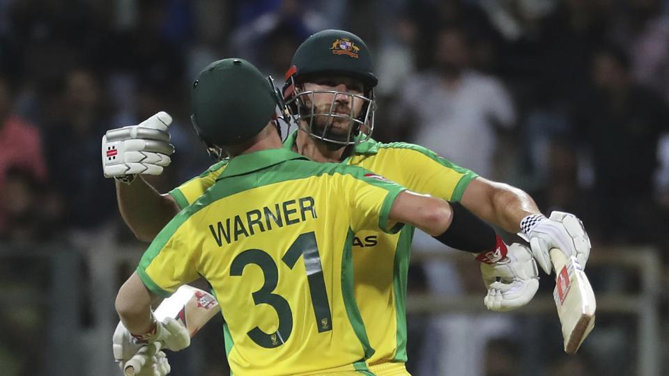Australia's captain Aaron Finch, facing camera greets David Warner after they won the match against India during the first one-day international cricket match between India and Australia in Mumbai, India, Tuesday, Jan. 14, 2020. (AP Photo/Rafiq Maqbool)