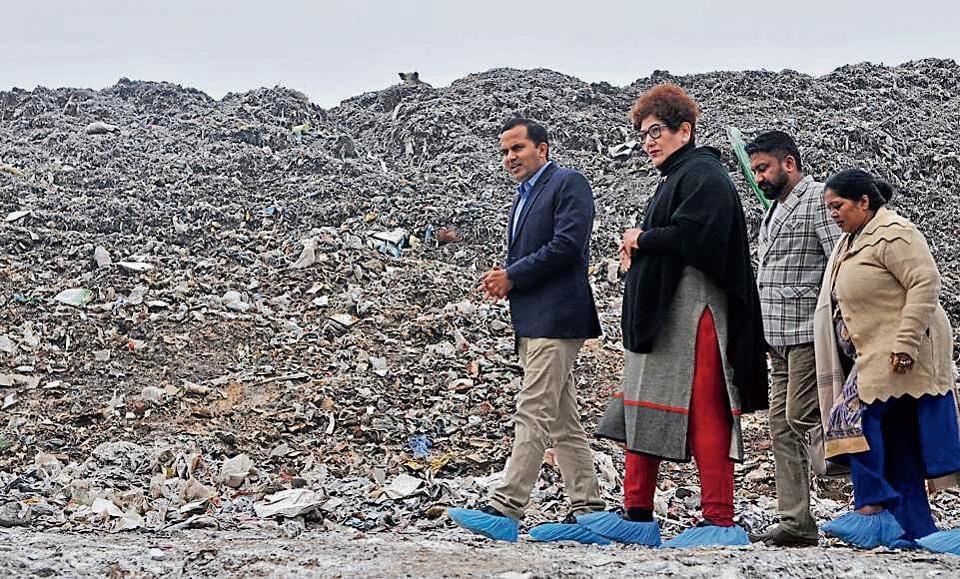 Mayor Raj Bala Malik and MC commissioner KK Yadav at the garbage dumping ground in Dadumajra on Wednesday. They were there to inspect the adjoining garbage processing plant, and came down heavily on its management, putting the blame on them for the city faltering in Swachh Survekshan.