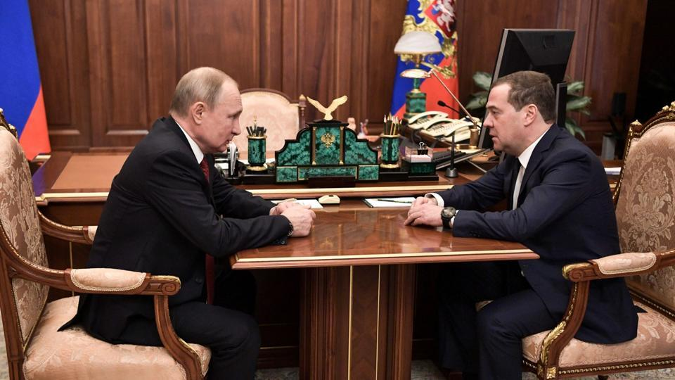Russian President Vladimir Putin meets with Prime Minister Dmitry Medvedev in Moscow on January 15, 2020. (Photo by Alexey NIKOLSKY / Sputnik / AFP)