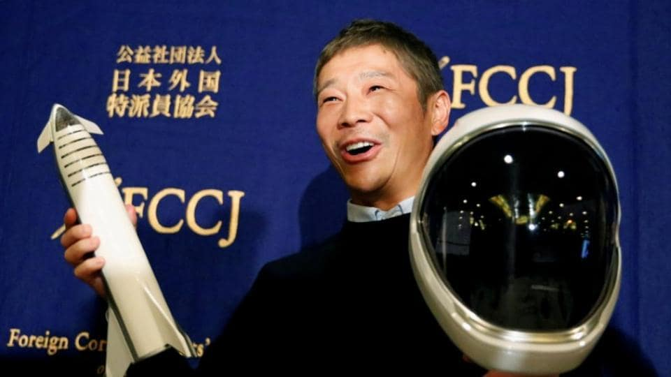 Japanese billionaire Yusaku Maezawa, who has been chosen as the first private passenger by SpaceX, poses for photos as he attends a news conference at the Foreign Correspondents' Club of Japan in Tokyo, Japan.