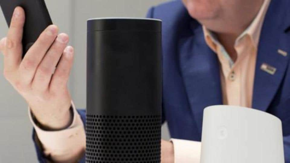 In this June 14, 2018, photo, an Amazon Echo, center, and a Google Home, right, are displayed in New York. Google contractors are listening to some recordings of people talking to Assistant, either on their phone or through smart speakers such as the Google Home. The company says some of its Dutch language recordings were leaked and that it is investigating.