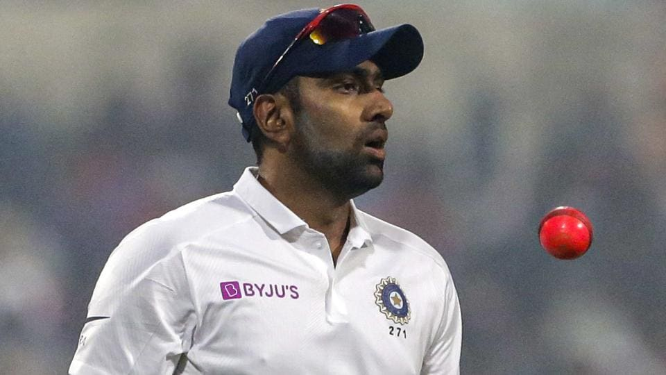 India's Ravichandran Ashwin tosses a pink ball.