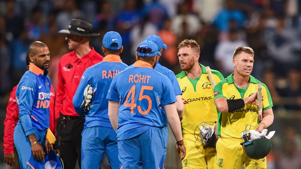 Australian batsman David Warner and Aaron Finch being congratulated by Indian players after they chased down the target to win the first one day international (ODI) cricket match at the Wankhede Stadium in Mumbai, Tuesday, Jan. 14, 2020.