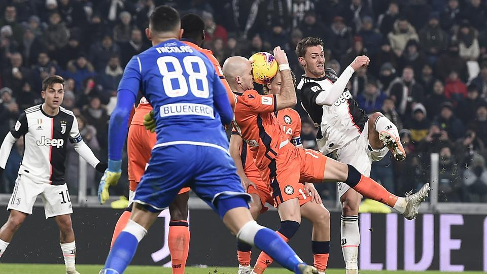 Juventus' Daniele Rugani, right, in action during the Italian Cup soccer match between Juventus and Udinese