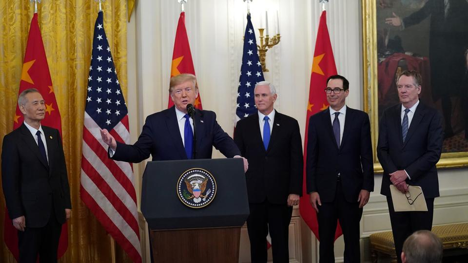 US president Donald Trump, Chinese Vice Premier Liu He, and US Vice President Mike Pence prior to signing