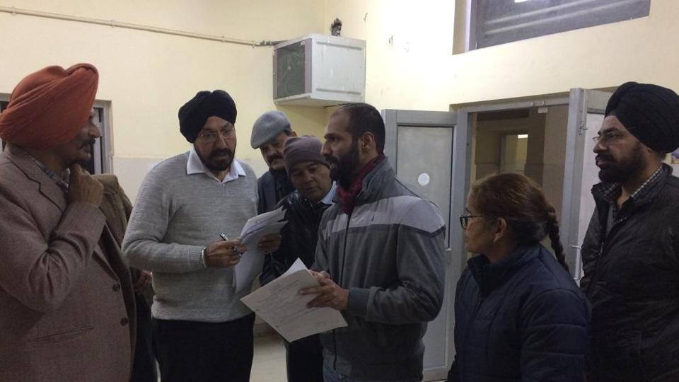 (From left) Councillor Satbir Singh Dhanoa and chairman of labour law committee, Mohali Industries' Association, Jasbir Singh, interacting with staff during a surprise check at ESI Hospital in Phase 7, Mohali, on Wednesday.