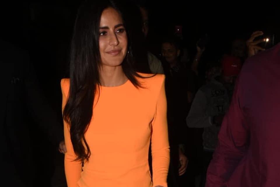 Katrina Kaif was spotted wearing a neon orange Alex Perry dress.