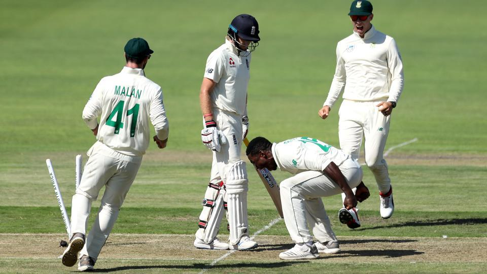 South Africa's Kagiso Rabada celebrates taking the wicket of England's Joe Root.