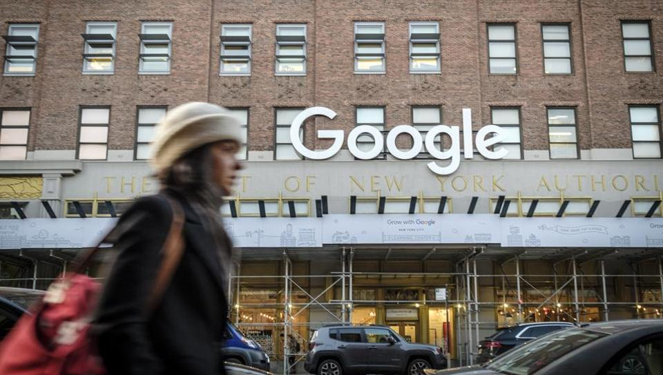 A pedestrian passes in front of Google headquarters in the Chelsea neighborhood of New York.