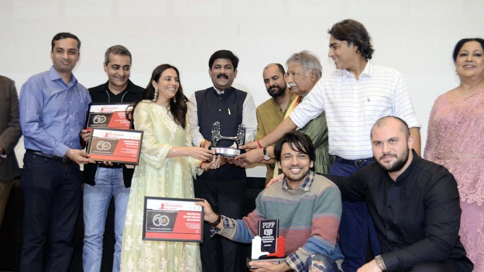 Cast and crew of Marathi film Anandi Gopal while receiving the best film award at Pune International Film Festival on Thursday.