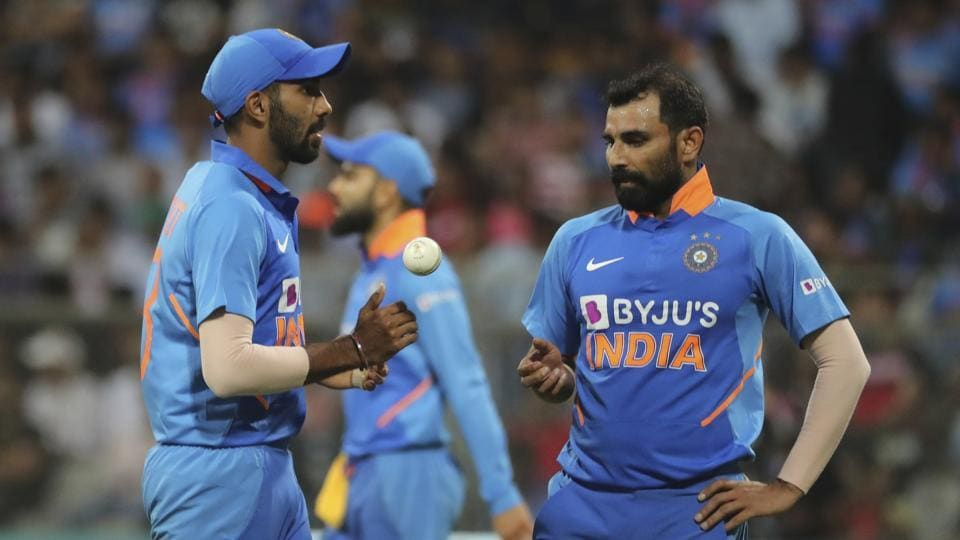 India's Jasprit Bumrah, left, chats with Mohammed Shami