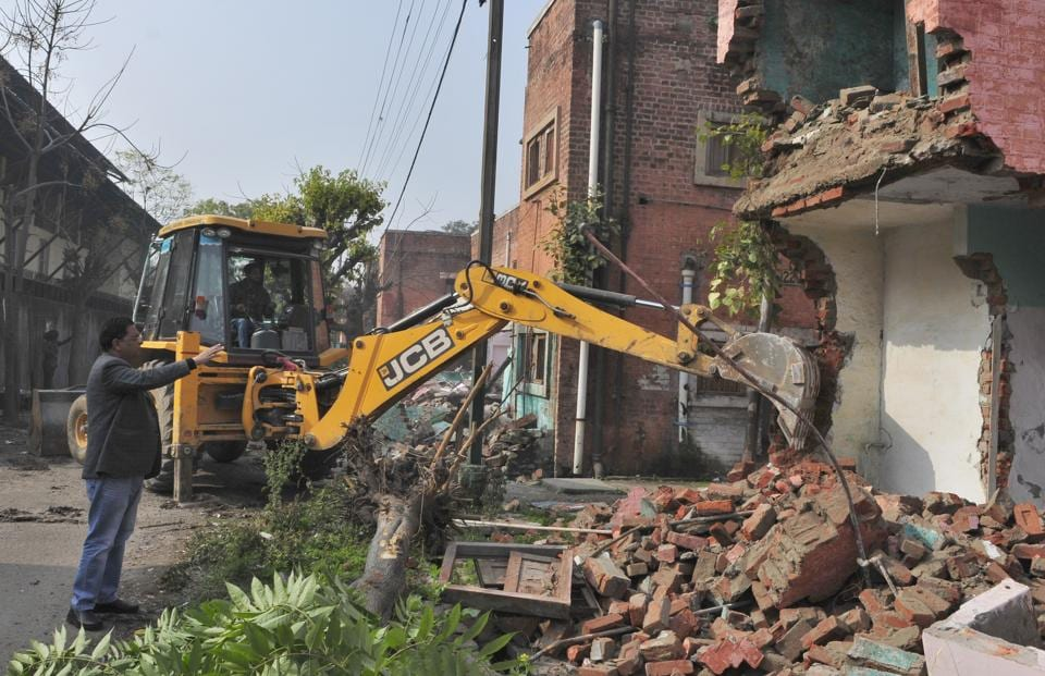 Railway officials demolishing unsafe quarters in colony number 10 in Ludhiana on January 17.