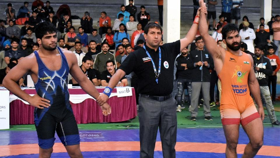 Referee raises the hand of Wrestler Gurpreet Singh after his victory against two-time World Junior Championships medallist Sajan Bhanwal.