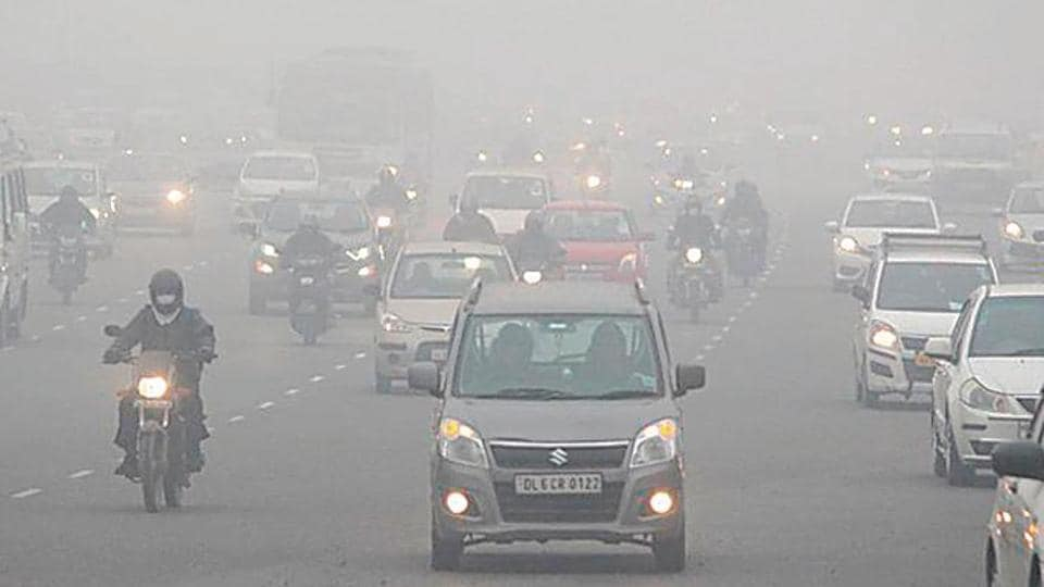Vehicles move amid heavy fog on the Delhi-Gurugram Expressway, in Gurugram on December 30.