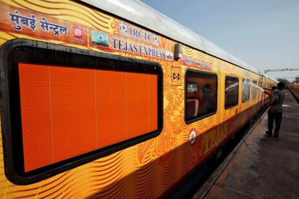 A man cleans the exteriors of a coach of India's first private train Tejas Express in Ahmedabad in this file photo.