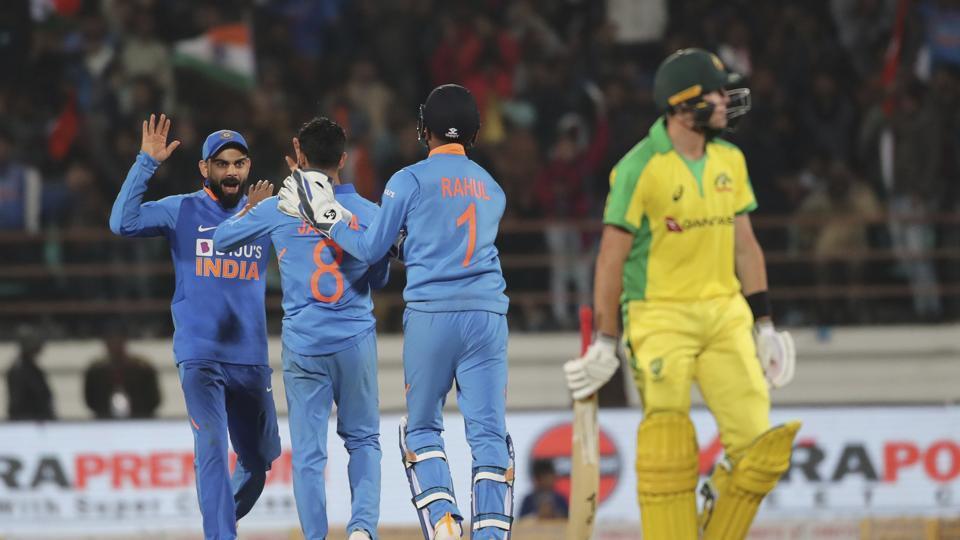 Indian cricket captain Virat Kohli, left, Ravindra Jadeja, second left, and Lokesh Rahul celebrate.