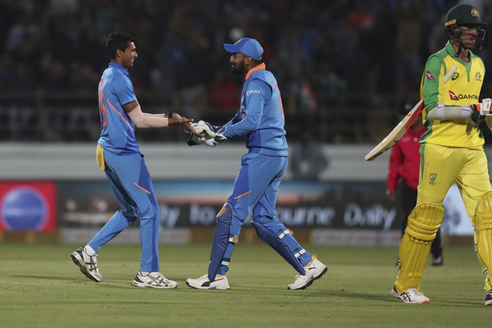 India's Navdeep Saini, left, and Lokesh Rahul celebrate the dismissal.