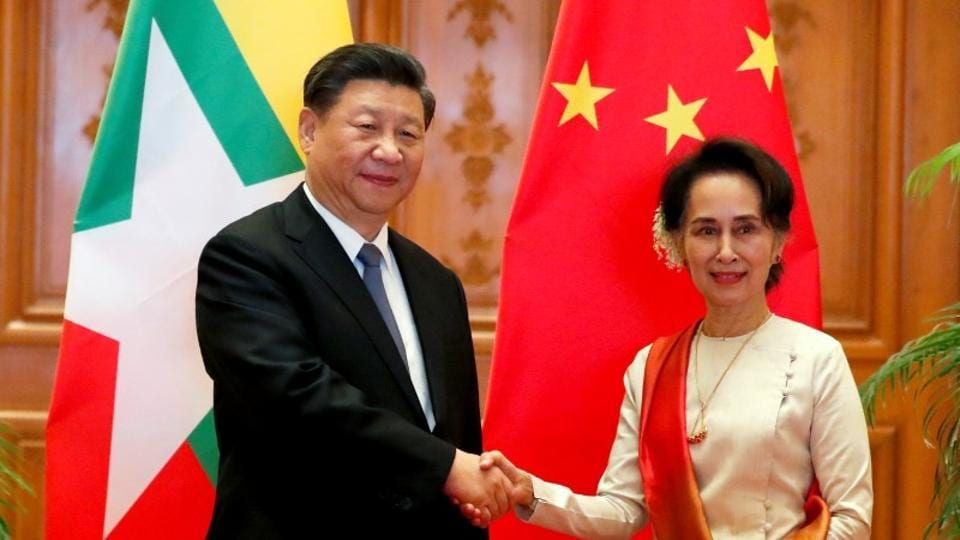 Myanmar State Counselor Aung San Suu Kyi shakes hands with Chinese President Xi Jinping at the Presidential Palace in Naypyitaw, Myanmar.