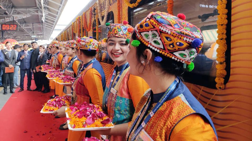 IRCTC employees are seen with flowers to welcome guests during the inaugural run of the Ahmedabad-Mumbai Tejas Express. Bookings for the train can be exclusively done either through IRCTC website, the mobile app Irctc Rail Connect, or IRCTC authorised agents. (ANI)