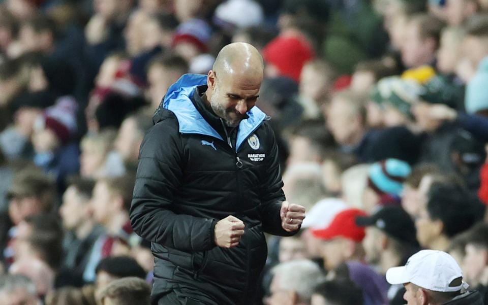 Manchester City manager Pep Guardiola celebrates.