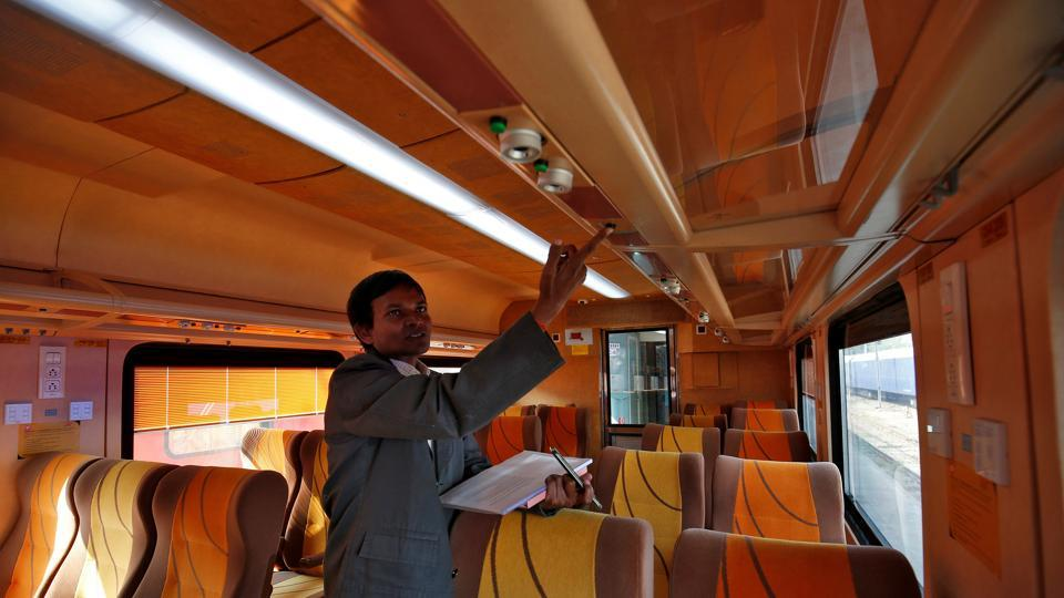"An official shows an overhead panel inside a coach during a media tour. ""The train will start its journey at Ahmedabad in the morning at 6.40 am and will reach Mumbai Central at 1.10pm,"" the railways said, adding that the train will leave Mumbai Central at 3:40pm for the return journey and will reach Ahmedabad at 9:55pm. (Amit Dave/REUTERS)"