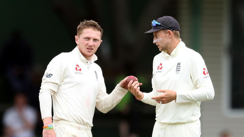 England's Dom Bess and Joe Root.