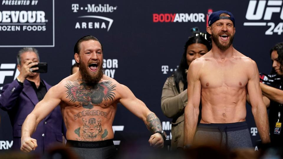 Conor McGregor and Donald Cerrone during the weigh-in.