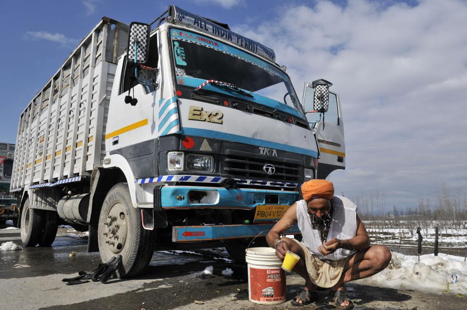 A stranded truck driver wash his face as he stranded at Srinagar-Jammu national highway.