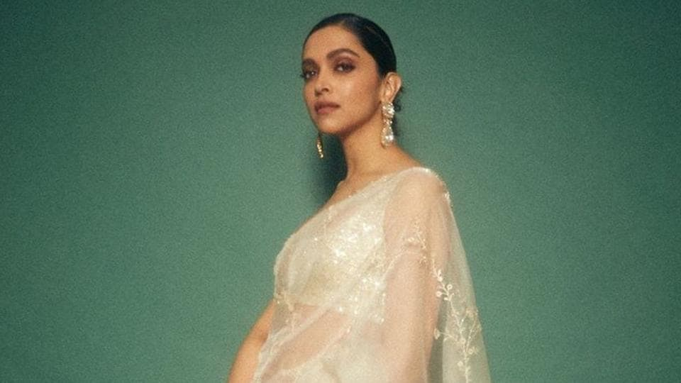 We absolutely love this sheer white embroidered organza saree by Sabyasachi Mukherji on Deepika, her hair as always tied in a neat bun, minimal dewy make-up and huge gemstone earrings adorned her ears. (instagram)