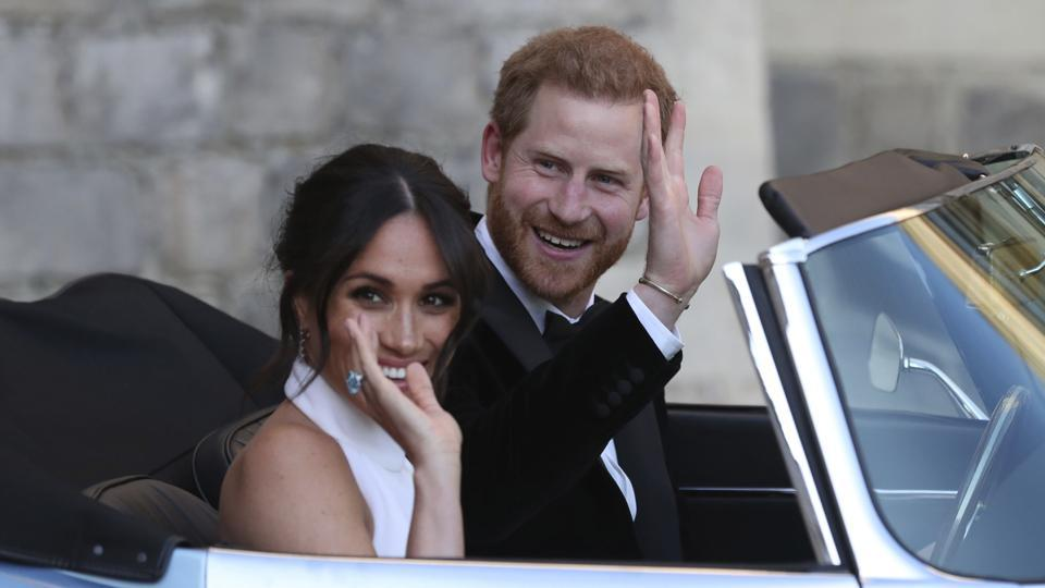 """Buckingham Palace says Prince Harry and his wife, Meghan, will no longer use the titles """"royal highness"""""""