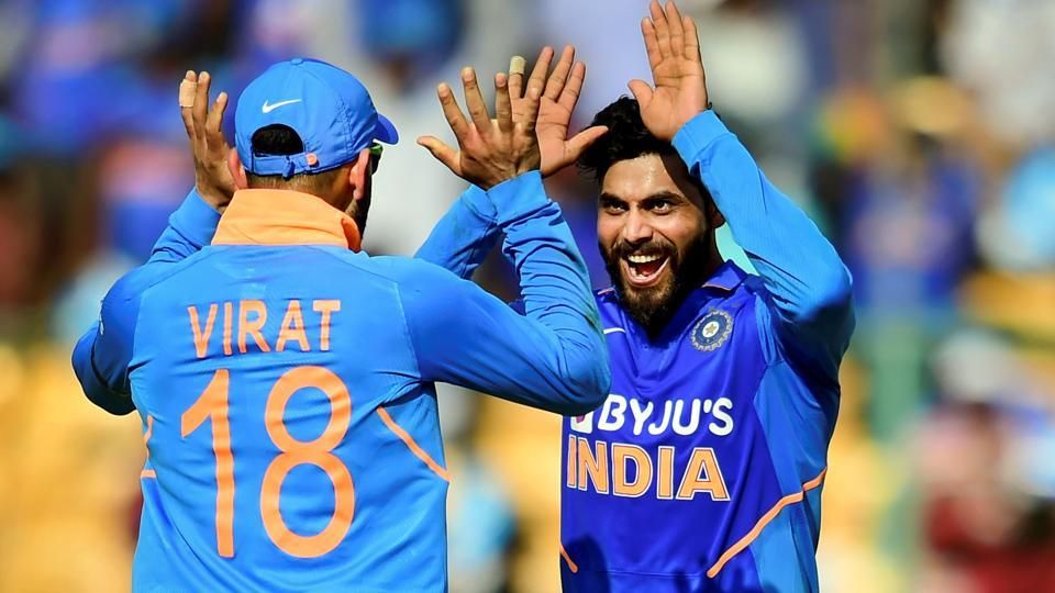 India's Ravindra Jadeja (R) celebrates with skipper Virat Kohli after taking the wicket of Australia's Mitchell Starc. (PTI)