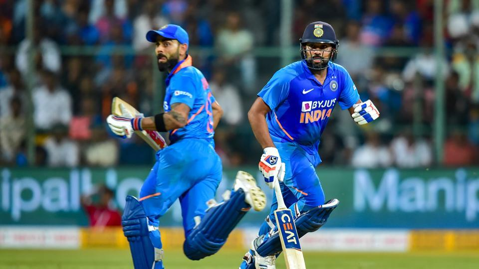 Rohit Sharma and Virat Kohli run between the wickets during the third and final ODI cricket match against Australia.