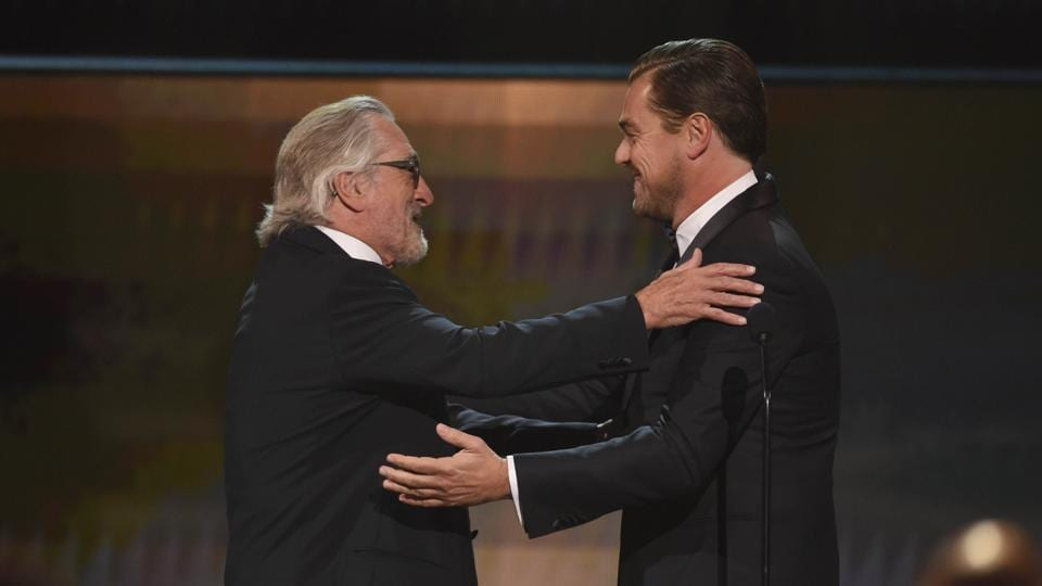 Leonardo DiCaprio, right, presents the lifetime achievement award to Robert De Niro at the 26th annual Screen Actors Guild Awards.