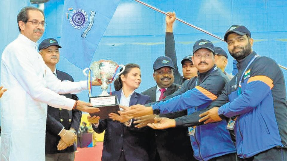 The Central Reserve Police Force men's team get the all-round trophy from Maharashtra chief minister Uddhav Thackeray in Pune on Saturday.