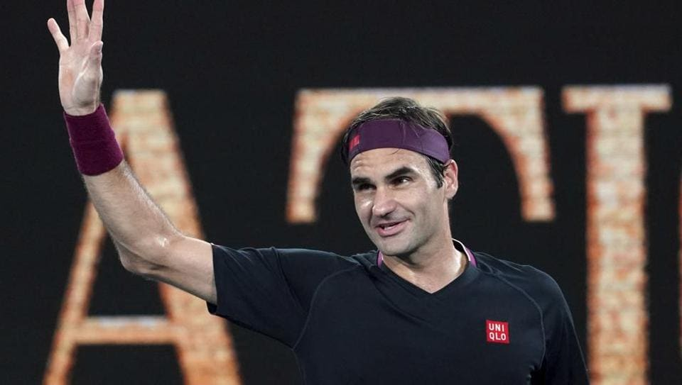 Switzerland's Roger Federer celebrates after defeating United States' Steve Johnson during their first round singles match at the Australian Open tennis championship in Melbourne, Australia