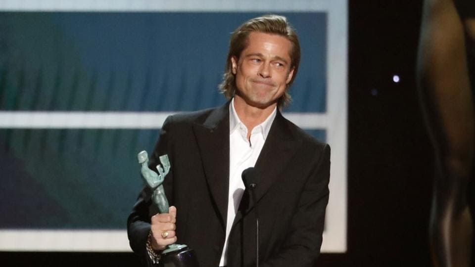 US actor Brad Pitt accepts the awards for Outstanding Performance by a Male Actor in a Supporting Role during the 26th Annual Screen Actors Guild Awards.