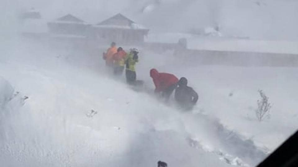 Climbers await rescue after an avalanche hit in Deurali, Nepal January 18, 2020 in this picture obtained from social media. Picture taken January 18, 2020. Simrik Air/Captain Ananda Thapa.