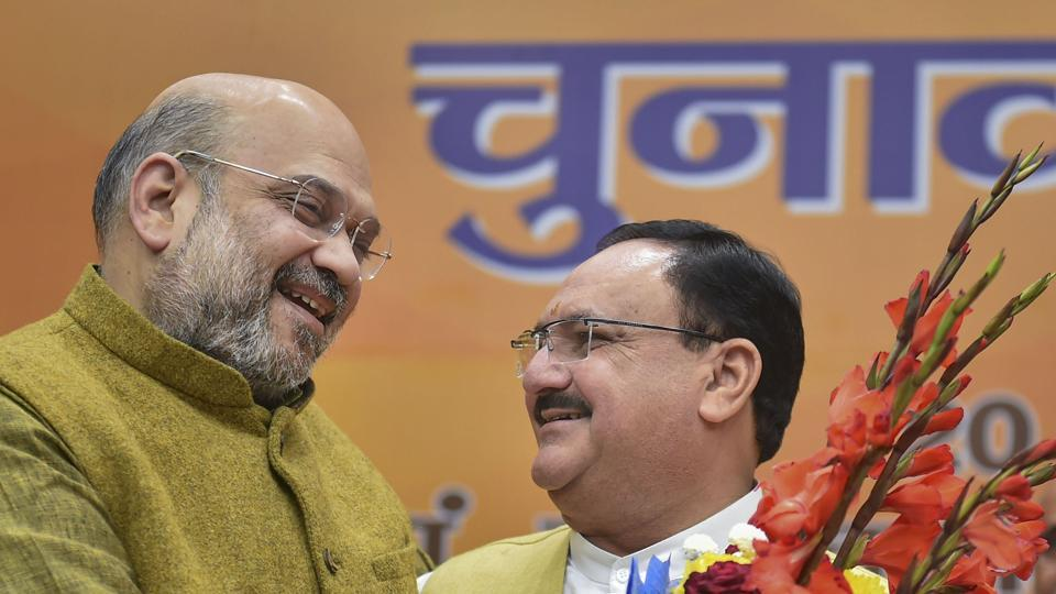 Union Home Minister Amit Shah greets Jagat Prakash Nadda, as the latter formally takes charge as BJP president on Monday.