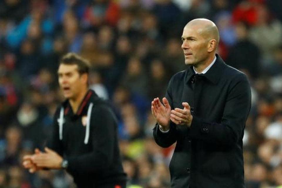 Real Madrid coach Zinedine Zidane and Sevilla coach Julen Lopetegui react.