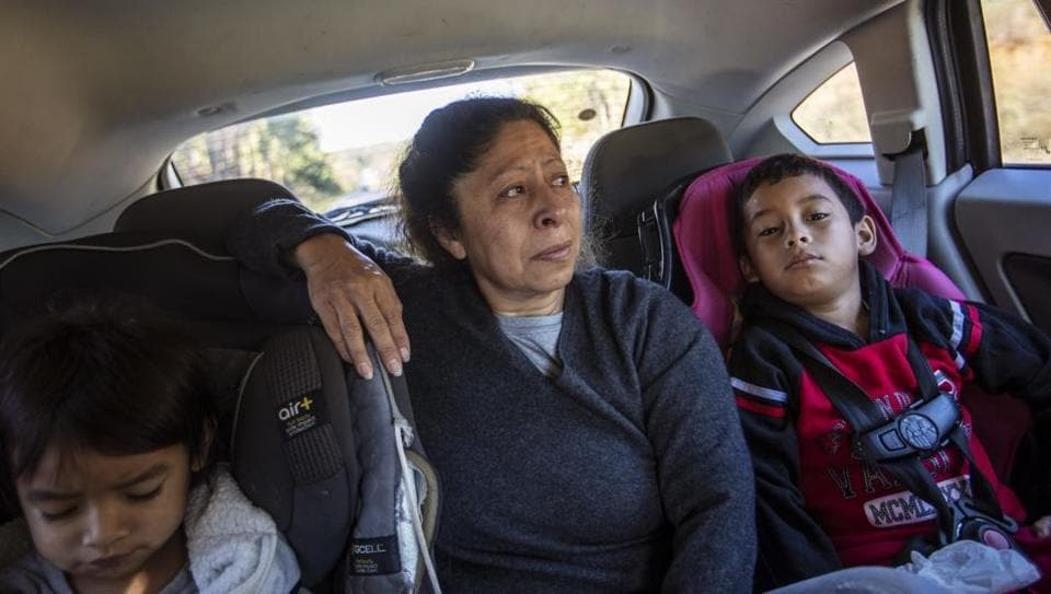 Maria Campos in the back seat of a car with her grandchildren, her eyes welling with tears as the immigration centre comes into view. The seven-hour drive from North Carolina to the Stewart Detention Centre in Georgia has become all too familiar. One of her sons was held here before being deported back to Mexico last year, leaving behind his wife and children, who accompany Campos now. (David Goldman / AP)