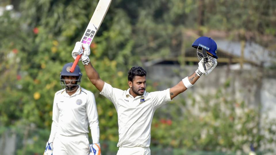 Nadia: Bengal batsman Manoj Tiwary (C) raises his bat after scoring 300.