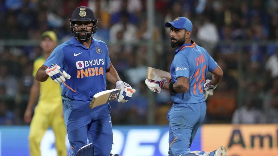 India's captain Virat Kohli, right, and Rohit Sharma run between the wickets to score during the third one-day international cricket match between India and Australia in Bangalore, India, Sunday, Jan. 19, 2020. (AP Photo/Aijaz Rahi)