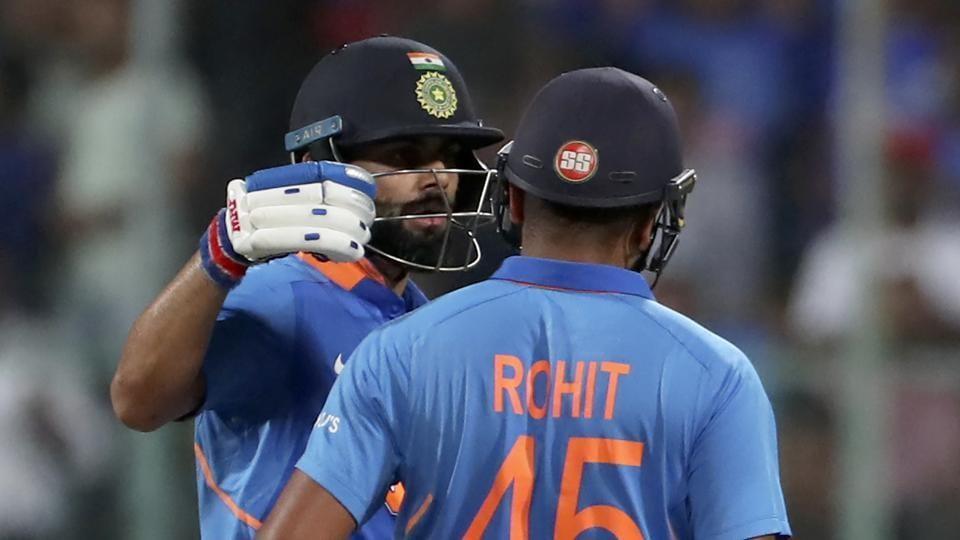 India's captain Virat Kohli, left, congratulates teammate Rohit Sharma on scoring a century.