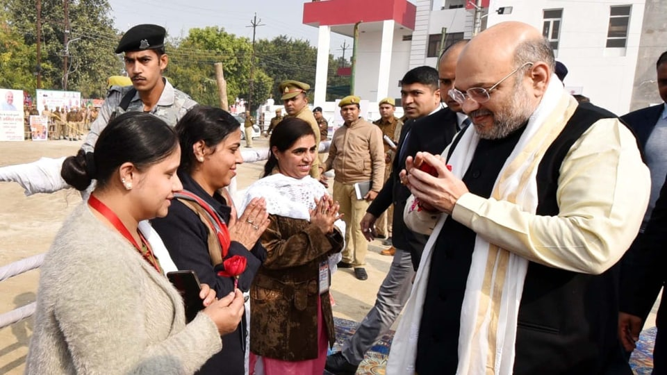 Union Home Minister meeting  a group of refugees from Afghanistan, Pakistan and Bangladesh in Lucknow on Tuesday.