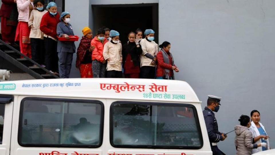Hospital staff observe as the bodies of eight Indian tourists who died due to suspected suffocation are carried inside an ambulance while being taken for postmortem in Kathmandu, Nepal January 21, 2020.