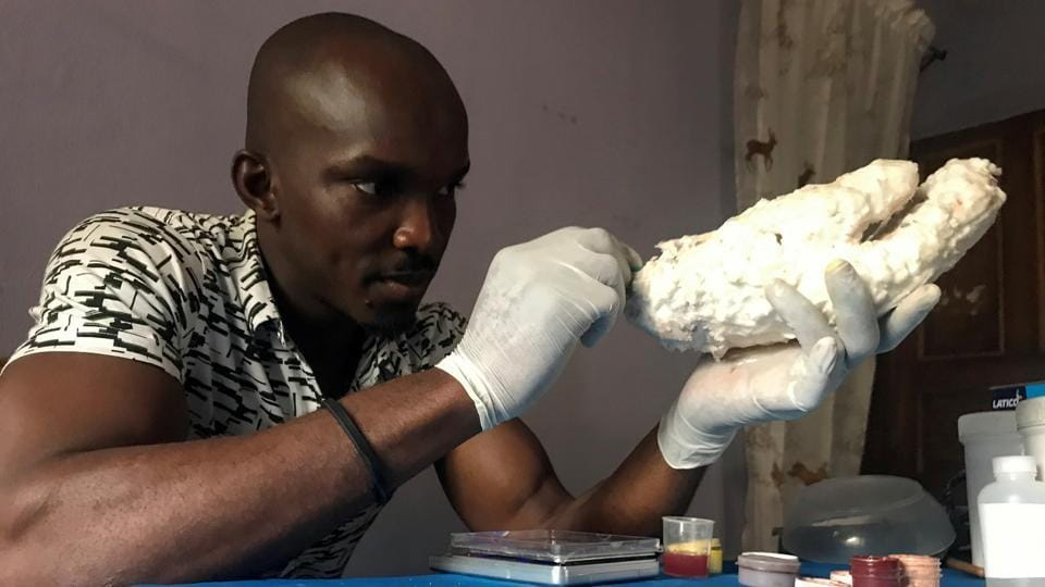 John Amanam, a 32-year-old former movie special effects expert, works on a prosthetic hand at his company, Immortal Cosmetic Art, in Uyo, Nigeria.